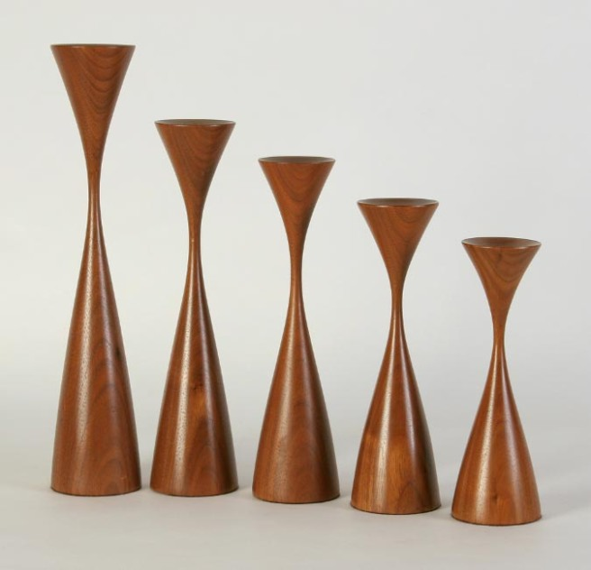 This is a photo from Rude's website showing his iconic candle holders.  These are walnut.