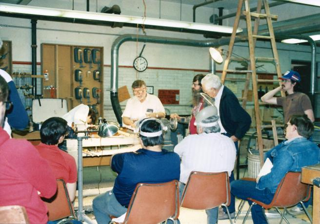 Here's a picture of me (in red) watching Rude Osolnik turn at a workshop at NCSU in the early 80's.
